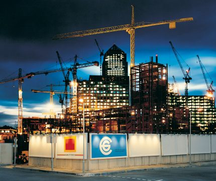 Lit construction site at dusk